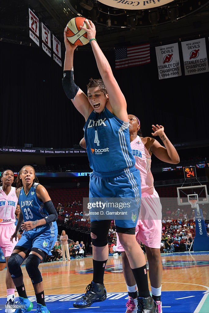 Janel McCarville #4 of the Minnesota Lynx rebounds against the New York Liberty during the game on August 27, 2013 at Prudential Center in Newark, New Jersey.