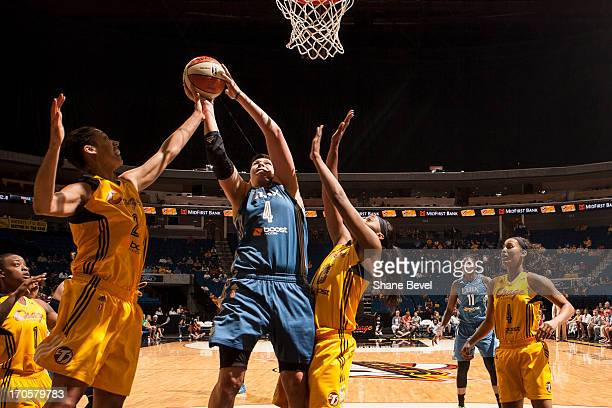Janel McCarville of the Minnesota Lynx shoots against Nicole Powell and Glory Johnson of the Tulsa Shock during the WNBA game on June 14 2013 at the...
