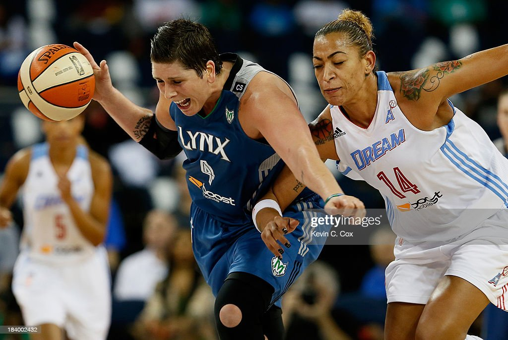 Janel McCarville #4 of the Minnesota Lynx steals the ball from Erika de Souza #14 of the Atlanta Dream during Game Three of the 2013 WNBA Finals at Philips Arena on October 10, 2013 in Atlanta, Georgia.