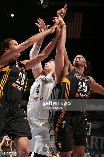 Janel McCarville of the Minnesota Lynx struggles to shoot against Nicole Powell and Glory Johnson of the the Tulsa Shock during the WNBA game on June...