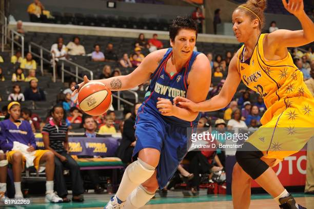 Janel McCarville of the New York Liberty drives against Christi Thomas of the Los Angeles Sparks July 1 2008 at Staples Center in Los Angeles...