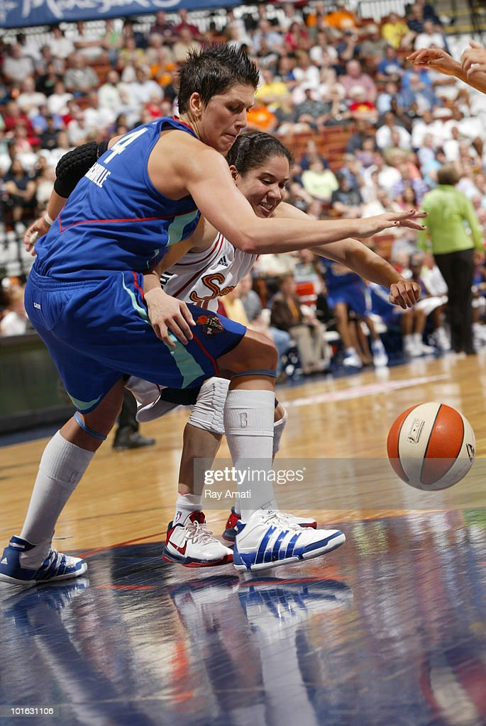 Janel McCarville #23 of the New York Liberty fights for the loose ball against Kara Lawson #20 of the Connecticut Sun during the game on June 4, 2010 at Mohegan Sun Arena in Uncasville, Connecticut.