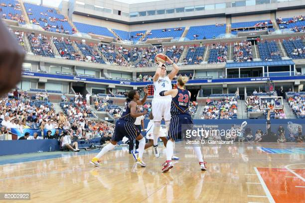 Janel McCarville of the New York Liberty shoots against Katie Douglas of the Indiana Fever at the 2008 Liberty Outdoor Classic on July 19 2008 at...