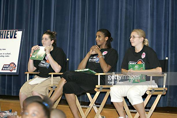 Janel McCarville Tammy SuttonBrown and Caity Matter of the Charlotte Sting read to children during the Sting's Read to Achieve event on August 6 2005...