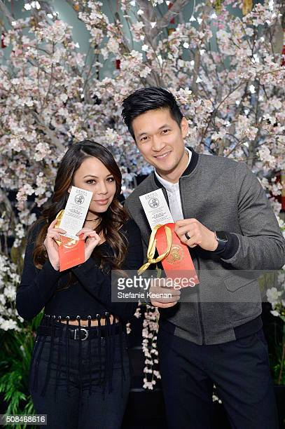 Janel Parrish and Harry Shum Jr attend the 2016 Lunar New Year Celebration at Beverly Center on February 4 2016 in Los Angeles California