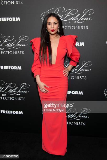 Janel Parrish arrives at the 'Pretty Little Liars: The Perfectionists' premiere at Hollywood Athletic Club on March 15, 2019 in Hollywood, California.
