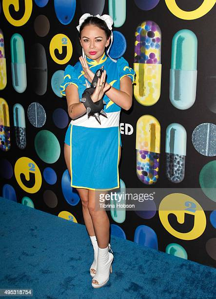 Janel Parrish attends the Just Jared Halloween Party at No Vacancy on October 31, 2015 in Los Angeles, California.