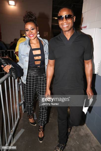 Janell Snowden and Doiggie Fresh backstage at the 2017 Hot 97 Summer Jam at MetLife Stadium on June 11 2017 in East Rutherford New Jersey