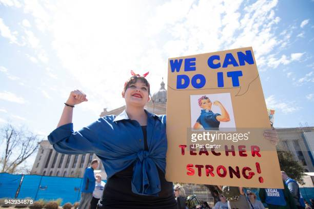Janelle Cox walks the picket line at the state capitol on April 9 2018 in Oklahoma City Oklahoma Thousands of teachers and supporters were expected...