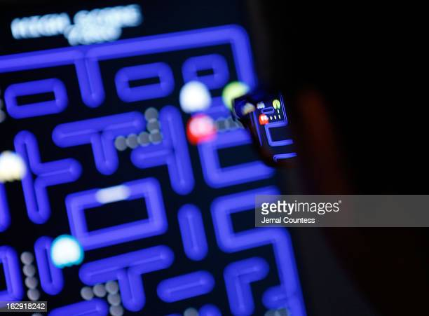 Janelle Grace plays 'PacMan' which is one of the 14 video games that are part of the exhibiton 'Applied Designs' during the 'Applied Design' press...