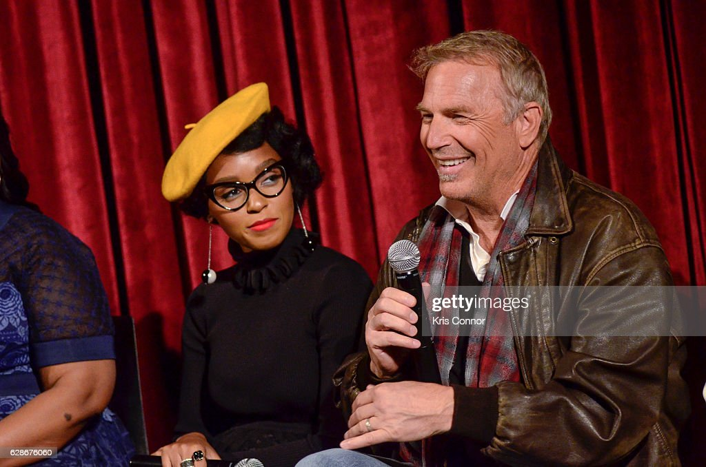 Janelle Monae and Kevin Costner speak during an official academy screening of HIDDEN FIGURES hosted by the The Academy of Motion Picture Arts and Sciences at MOMA - Celeste Bartos Theater on December 8, 2016 in New York City.