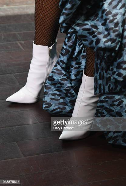 Janelle Monae boot detail visits 'Extra' at R Lounge at the Renaissance Hotel on April 9 2018 in New York City