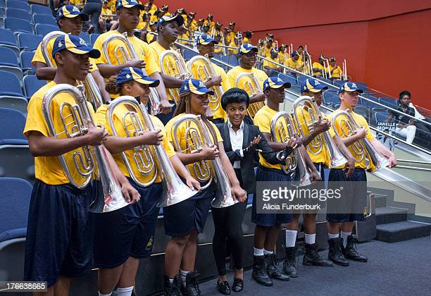 Janelle Monae takes photos with members of The Blue and Gold Marching Band at North Carolina Agricultural & Technical State University on the...
