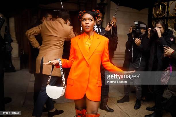 Janelle Monae wearing Stella McCartney orange suit, orange leather patent boots, white leather bag outside Stella McCartney during Paris Fashion Week...