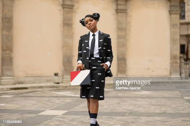 Janelle Monáe is seen on the street attending THOM BROWNE during Paris Fashion Week AW19 wearing THOM BROWNE blazer, shorts and bag with black tie on...