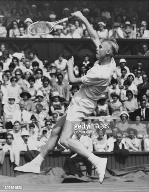 Jan-Erik Lundqvist of Sweden reaches to play an overhead return to Dennis Ralston of the United States during their Men's Singles Second Round match...