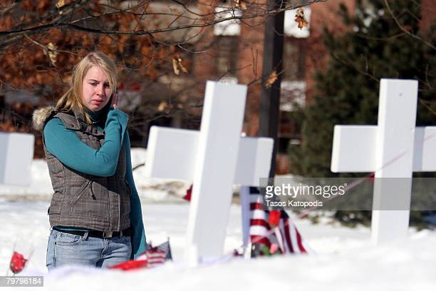 Janessa Keua a freshman at Northern Illinois University pays her respects at the memorial on the campus of NIU February 16 2008 in De Kalb Illinois...
