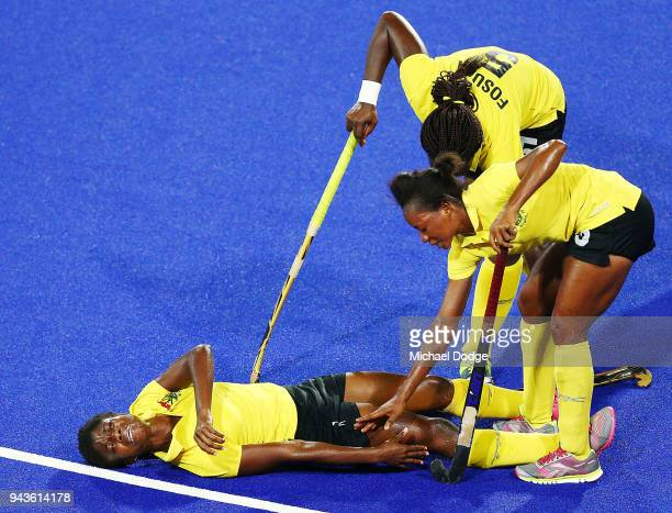 Janet Adampa of Ghana after colliding into Mairi Drummond of Scotland during Hockey on day five of the Gold Coast 2018 Commonwealth Games at Gold...