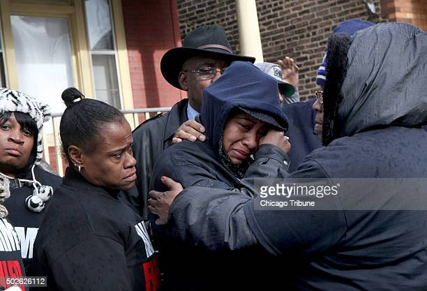 Janet Cooksey center the mother of Quintonio LeGrier is comforted by family and friends during a press conference on Sunday Dec 27 to speak out about...