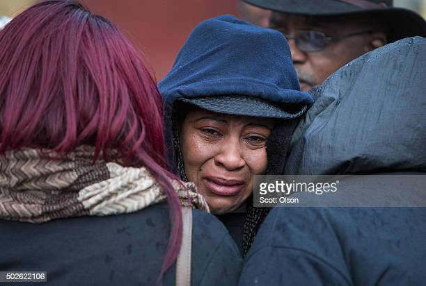 Janet Cooksey is comforted as she listens to speakers talk about the deaths of her son Quintonio LeGrier and Bettie Jones before the start of a vigil...