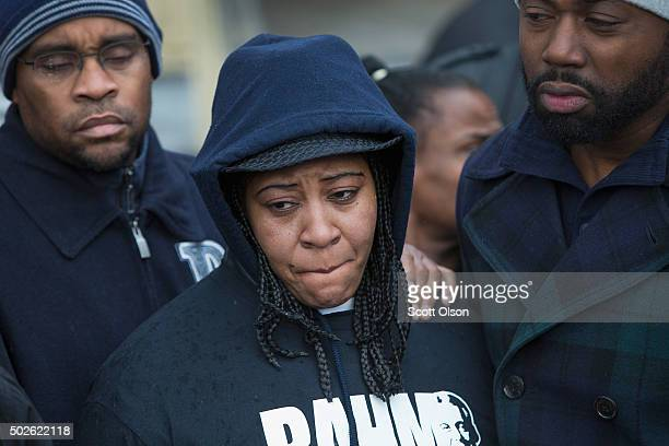 Janet Cooksey listens to speakers talk about the deaths of her son Quintonio LeGrier and Bettie Jones before the start of a vigil on December 27 2015...