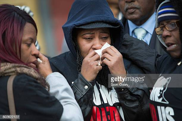 Janet Cooksey wipes away tears as she listens to speakers talk about the deaths of her son Quintonio LeGrier and Bettie Jones before the start of a...
