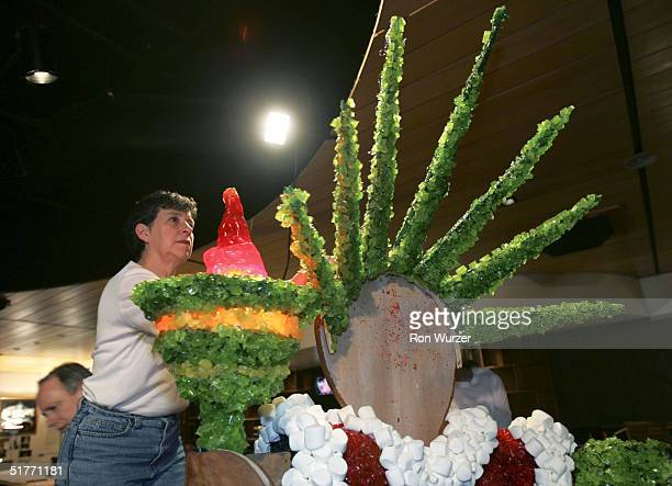 Janet Donaldson works on securing the crown to a gingerbread and candy reproduction of the Statue f Liberty for a contest based on the theme Miracle...