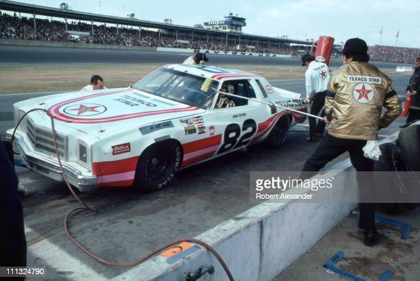 Janet Guthrie driver of the Texaco Monte Carlo makes a pit stop during the 1980 Daytona 500 on February 17 1980 in Daytona Beach Florida In the 1980...