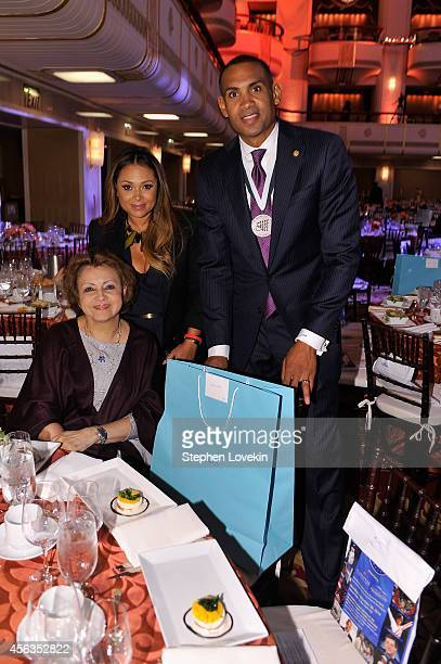 Janet Hill singersongwriter Tamia and former basketball player Grant Hill attends the 29th Annual Great Sports Legends Dinner to benefit The...