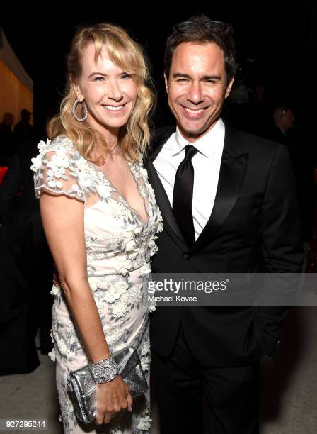 Janet Holden and Eric McCormack and attend the 26th annual Elton John AIDS Foundation Academy Awards Viewing Party sponsored by Bulgari celebrating...