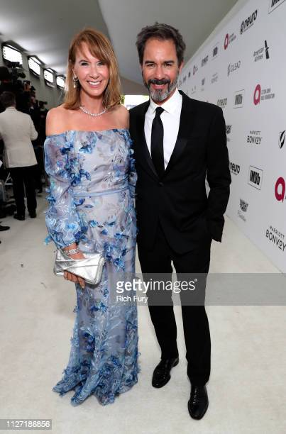 Janet Holden and Eric McCormack attend the 27th annual Elton John AIDS Foundation Academy Awards Viewing Party sponsored by IMDb and Neuro Drinks...