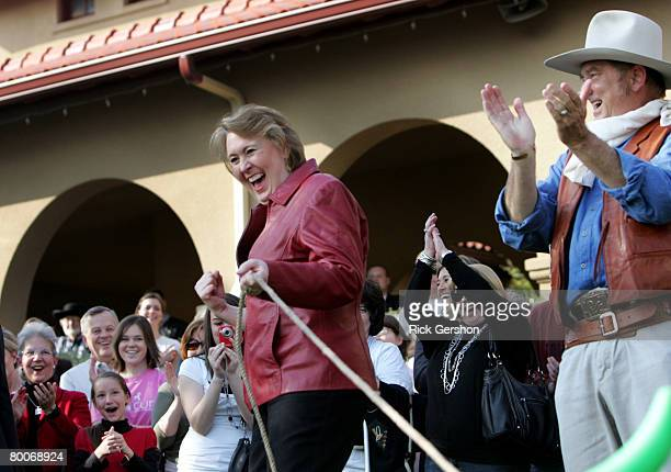 Janet Huckabee learns how to rope with her husband Republican presidential hopeful and former Arkansas Gov Mike Huckabee in front of supporters at...