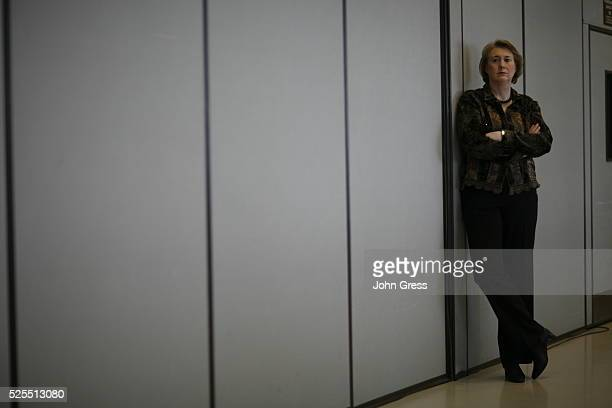 Janet Huckabee listens as her husband Republican presidential hopeful Mike Huckabee campaigns in Appleton, Wisconsin.