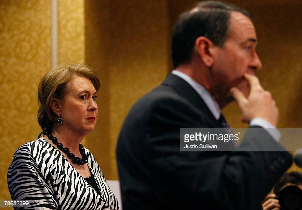 Janet Huckabee looks on as her husband, Republican presidential hopeful and former Arkansas Gov. Mike Huckabee, speaks during a news conference at...