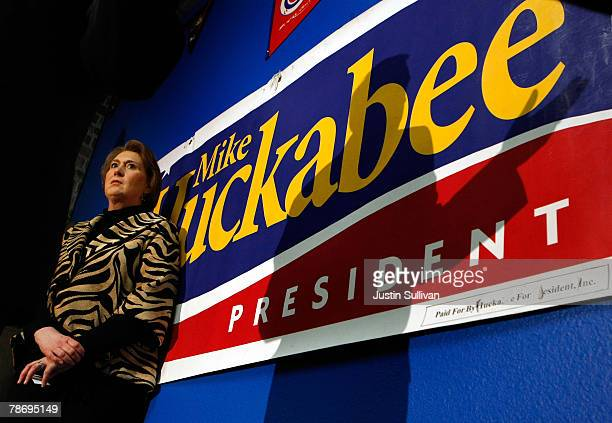 """Janet Huckabee watches her husband, Republican presidential hopeful and former Arkansas governor Mike Huckabee, speak during a """"Meet Mike Huckabee""""..."""