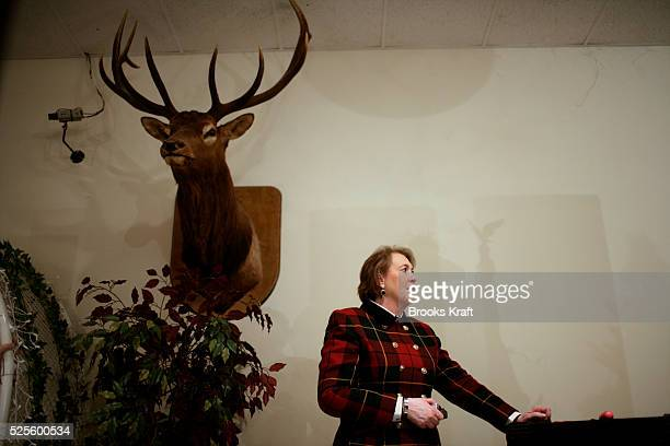 Janet Huckabee, wife of Republican presidential candidate Mike Huckabee, listens to her husband speak during a campaign stop in Cedar Rapids, Iowa.