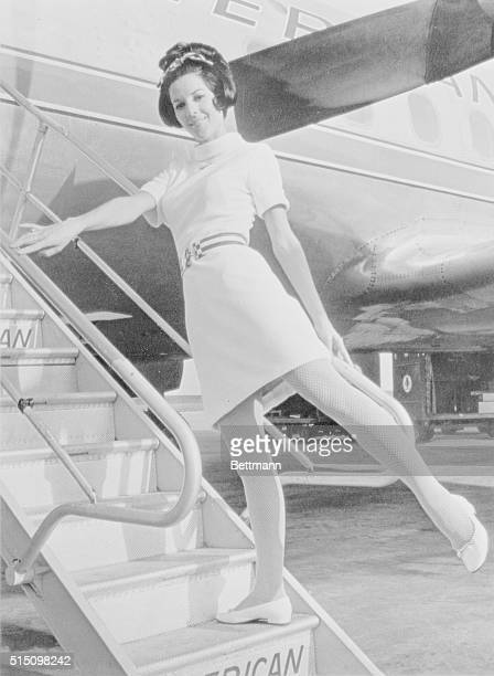 Janet Jackson a stewardess for American Airlines models a mini skirted uniform which was being considered by the airline for the next year winter...