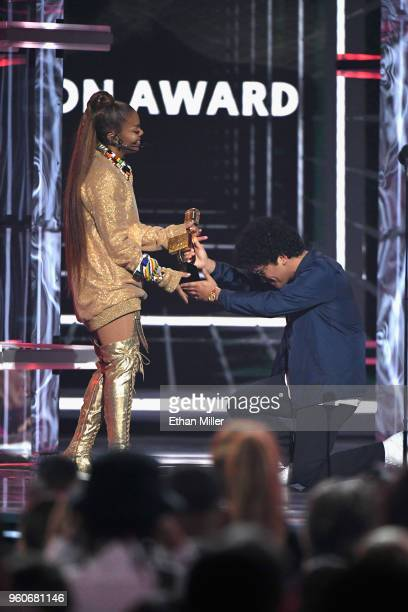 Bruno Mars presents Janet Jackson with an award onstage during the 2018 Billboard Music Awards at MGM Grand Garden Arena on May 20 2018 in Las Vegas...