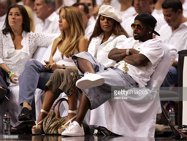 Janet Jackson and Jermaine dupri watch Game 7 of the Eastern Conference Finals between the Miami Heat and Detroit Pistons at American Airlines Arena...