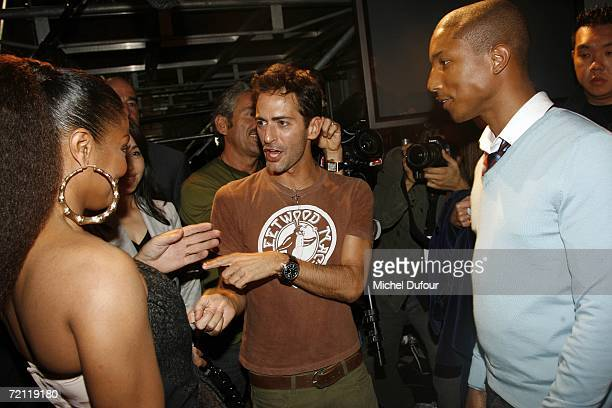 Janet Jackson Marc Jacobs and Pharrell Williams speak backstage at the Louis Vuitton Fashion Show as part of Paris Fashion Week Spring/Summer 2007 on...
