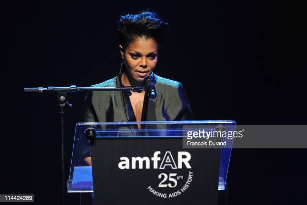 Janet Jackson speaks onstage at amfAR's Cinema Against AIDS Gala during the 64th Annual Cannes Film Festival at Hotel Du Cap on May 19, 2011 in...