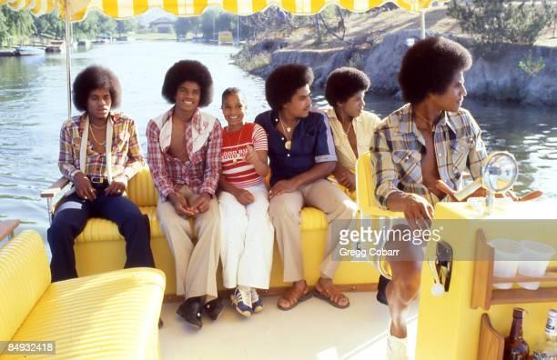 Janet Jackson with her brothers Marlon Jackson, Michael Jackson, Tito Jackson, Randy Jackson and Jackie Jackson of The Jacksons pose during a...