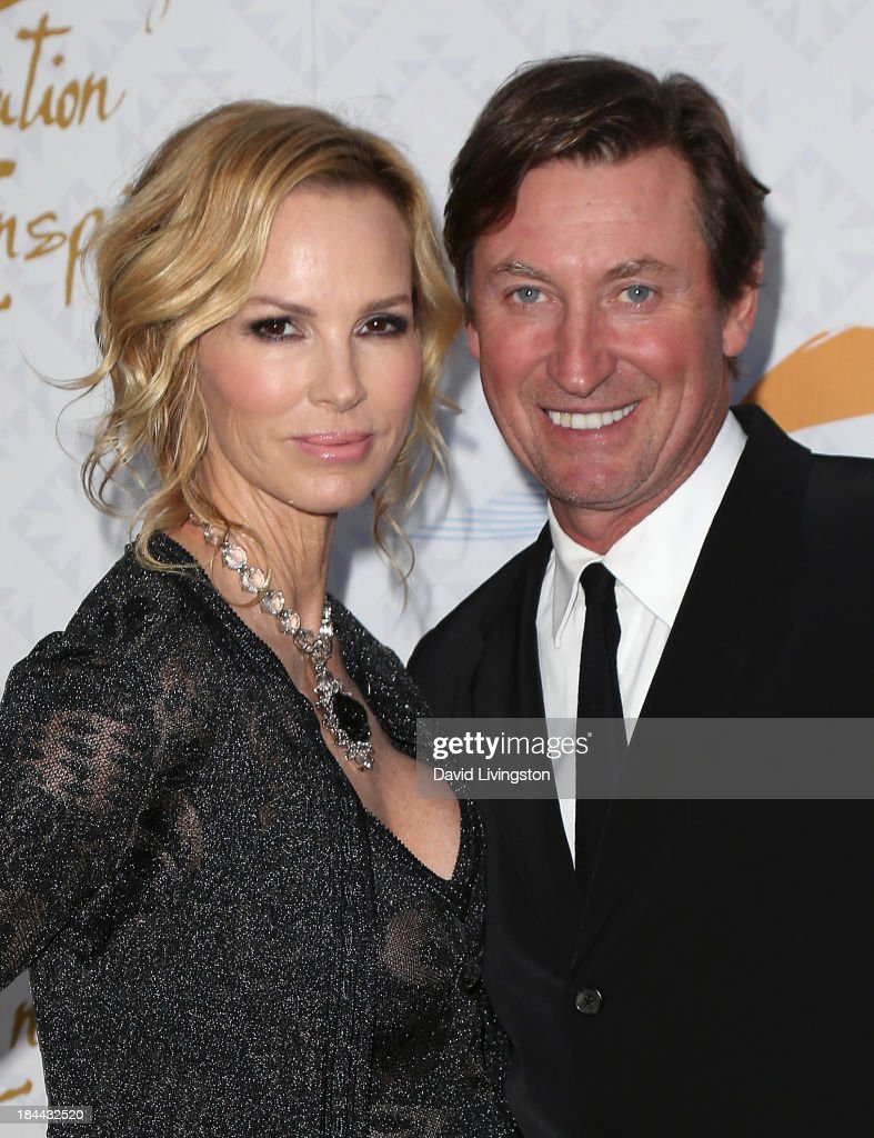 Janet Jones (L) and husband former NHL player Wayne Gretzky attend the 10th Annual Alfred Mann Foundation Gala in the Robinsons-May Lot on October 13, 2013 in Beverly Hills, California.