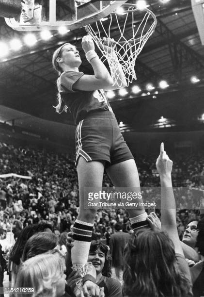 Janet Karvonen basketball star of the New York Mills MN high school team in the 1970s cut down the net Saturday March 24 after her team won the high...