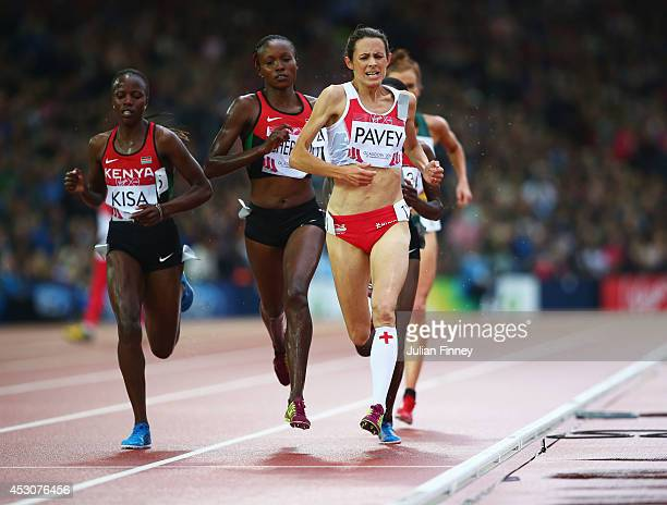 Janet Kisa of Kenya and Jo Pavey of England compete in the Women's 5000 metres final at Hampden Park during day ten of the Glasgow 2014 Commonwealth...