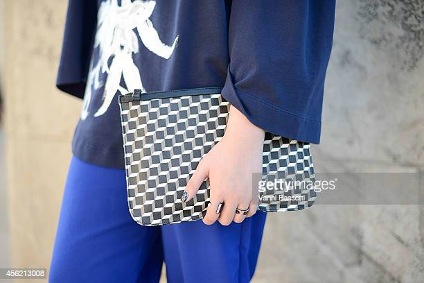 Janet Kseng poses wearing a Dries Van Noten top Zara pants and Pierre Hardy bag on September 27 2014 in Paris France