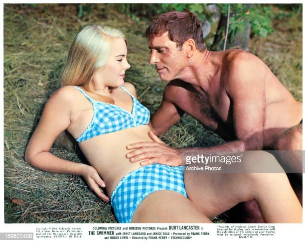 Janet Landgard and Burt Lancaster getting close on the grass in a scene from the film 'The Swimmer' 1968