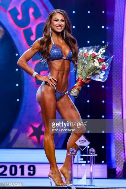 Janet Layug poses for photographers after winning Bikini International as part of the Arnold Sports Festival on March 2 at the Greater Columbus...