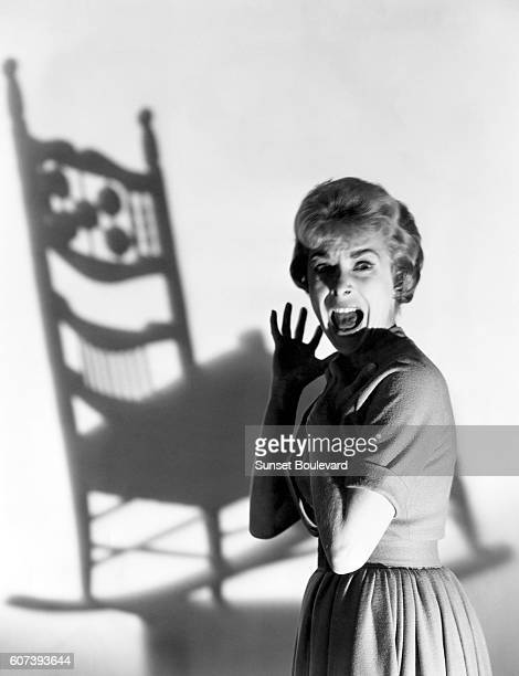"""Janet Leigh on the set of """"Psycho"""", directed by Alfred Hitchcock."""