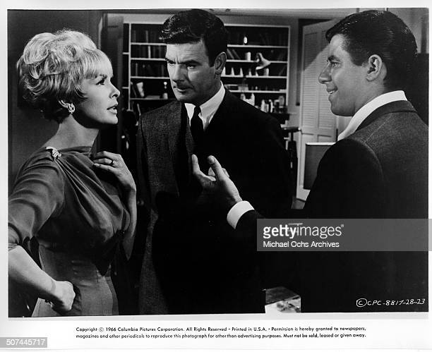 Janet Leigh talks with Jerry Lewis as James Best listens in a scene from the movie Three on a Couch circa 1966